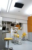 Modern Office, Colorful Dentist Chair, Ceiling TV Royalty Free Stock Photo