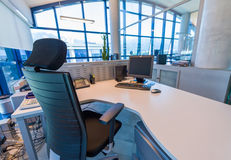 Modern office with confortable chair and desktop pc Royalty Free Stock Photography