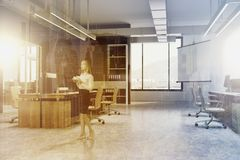 Black wall open space office corner, screen, woman Stock Image
