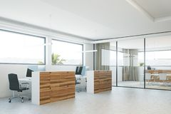 Wooden and white office corner. Modern office corner with a concrete floor, wooden columns and computer tables. 3d rendering mock up Royalty Free Stock Image