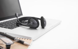 Modern Office desk with computer, notebook, headset Royalty Free Stock Photography