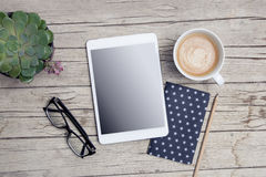 Modern office desk with mock up tablet and handy royalty free stock photography