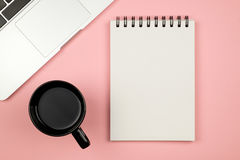 Modern office desk table with laptop, blank notebook page Stock Image