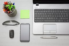 Modern office desk with working accessories, top view Royalty Free Stock Photos