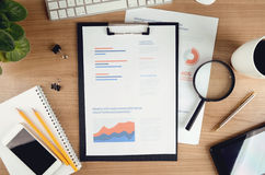 Modern office desktop with financial report Royalty Free Stock Images