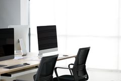 Modern office with documents and computers on the table. royalty free stock photos