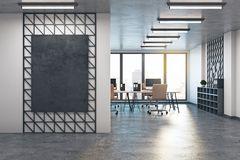 Modern office with empty poster. Modern office interior with empty poster on wireframe wall and sunlight. Mock up, 3D Rendering Stock Photos