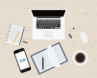 Modern office or freelancer workplace with laptop,notebook, coffee, pen, smartphone and mouse . Wood background. Top Royalty Free Stock Image