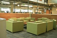 Modern Office Green chairs. A small corporate gathering place with bright green chairs in an ultra modern office building Stock Images