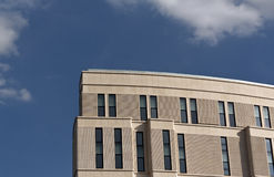 Modern office or hotel building against blue sky. Royalty Free Stock Image