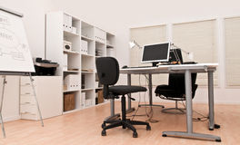 Modern office interior. Showing desk office chairs and a white board for mindstorming Royalty Free Stock Images