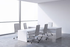 Modern office interior with huge windows and cope space panoramic view. White leather on the chairs and a white table. A concept o Royalty Free Stock Images