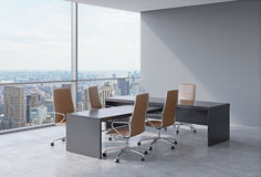 Modern office interior with huge windows and New York panoramic view. Brown leather on the chairs and a black table. A concept of Stock Image