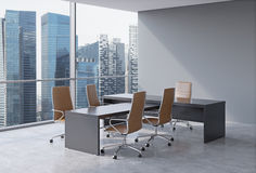Modern office interior with huge windows and skyscraper panoramic view. Brown leather on the chairs and a black table. A concept o Royalty Free Stock Photo