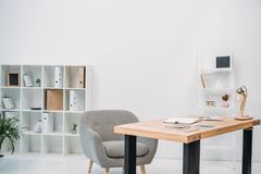Modern office interior with papers and digital tablet. On table royalty free stock images