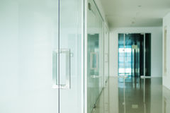 Modern office interior, selective focus on doorknob Royalty Free Stock Images