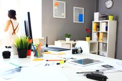 Modern office interior with tables, chairs and bookcase Stock Photography