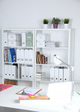 Modern office interior with tables, chairs and bookcases Stock Photography
