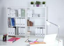 Modern office interior with tables, chairs and bookcases Royalty Free Stock Photo