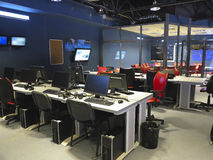 Modern office interior at a television studio with computers and Royalty Free Stock Photography