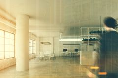 White office with a reception and columns, man. Modern office interior with a white reception counter, white walls and columns, large windows and an open space Stock Photo