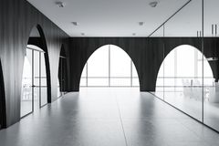 Modern office lobby, black walls, arches. Modern office lobby with a concrete floor, arched dark wooden walls and panoramic windows. 3d rendering mock up Stock Photo