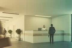 White and light wooden reception side people Stock Image
