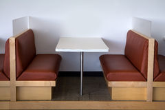 Modern office lunchroom clean view. Modern table and booth setup in an office lunchroom. Close up view shows one table. Very clean and spacious environment Stock Image