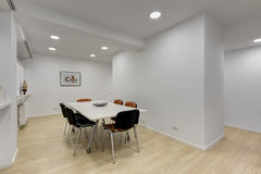 Modern office meeting room with table stock images