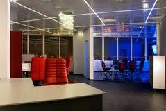 Modern office at night Royalty Free Stock Photos