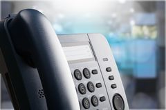 Modern office phone close-up view stock photography