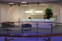 Modern office reception. Reception desk and waiting area within contemporary business office and modern design stock photos
