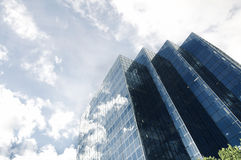 Modern office skyscraper and blue sky Stock Photos