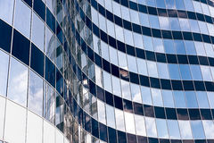 Modern office skyscraper with glass windows and sky reflection Royalty Free Stock Photos