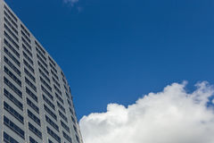 Modern office Skyscrapers on the blue sky with clouds Stock Images