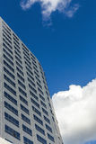 Modern office Skyscrapers on the blue sky with clouds Royalty Free Stock Photo