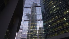 Modern, skyscrapers made of glass. Vertical panoramic view from below. Daytime stock video footage