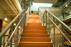 Modern Office Stairs; Going up. Industrial staircase with wire and recycled wood products Royalty Free Stock Photography