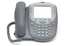 Modern office system phone with large LCD screen. Isolated on wh. Ite Royalty Free Stock Photo