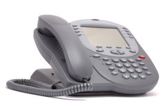 Modern office system phone with large LCD screen. Isolated on white Royalty Free Stock Image