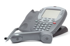 Modern office system phone with large LCD screen. On white Royalty Free Stock Image