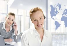 Modern office, two beautiful businesswoman Royalty Free Stock Images