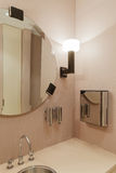 Modern office washroom interior. With mirror and lamps Royalty Free Stock Images
