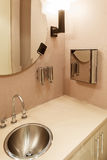 Modern office washroom interior. With mirror and lamps Royalty Free Stock Image