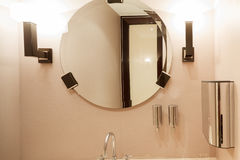 Modern office washroom interior. With mirror and lamps Stock Photos