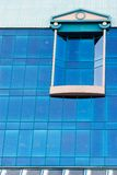 Modern office window. Feature of a modern glass coating of modern office buildings-strengthen blueness of the sky, thus making their elegant Stock Photo