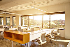 Modern office with windows and city view Stock Images