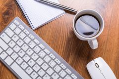 Modern office workplace. With a cup of coffee Royalty Free Stock Image