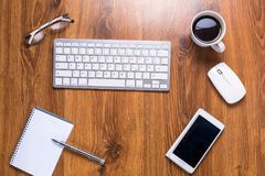 Modern office workplace. With a cup of coffee Royalty Free Stock Photo