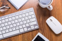 Modern office workplace. With a cup of coffee Royalty Free Stock Photos